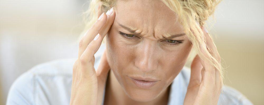 woman seeks tmd migraine relief