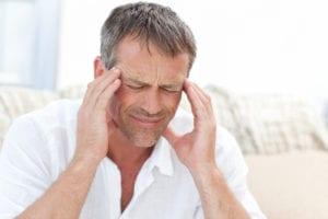 man with tmj pain migraine headache