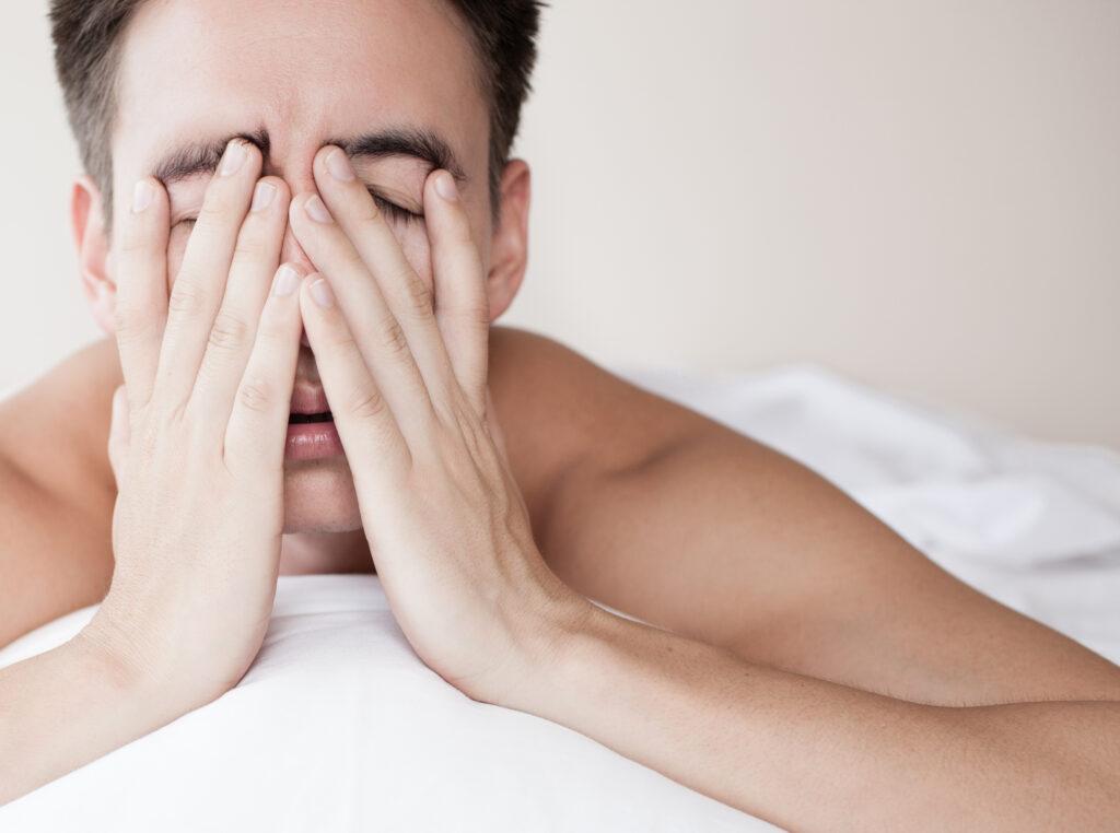 sleepy man in bed