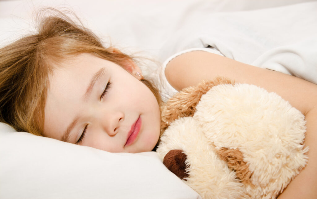 little girl asleep with stuffed puppy
